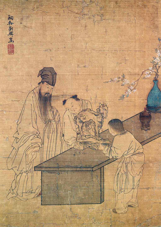 Llettré chinois devant une pierre en forme de chèvre.